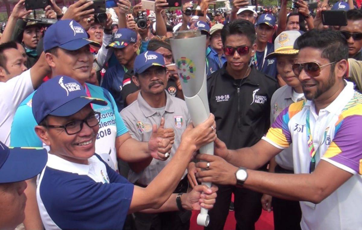 Dari Palembang, Api Obor Asian Games XVIII disambut Bupati Supriono